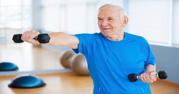 blog picture of elderly man working out with light weights