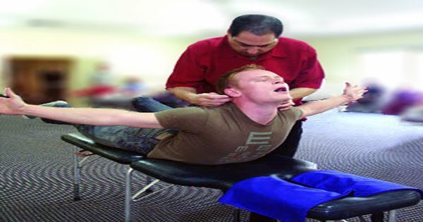 blog picture of man receiving network therapy from chiropractor