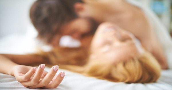 blog picture of man and woman on bed