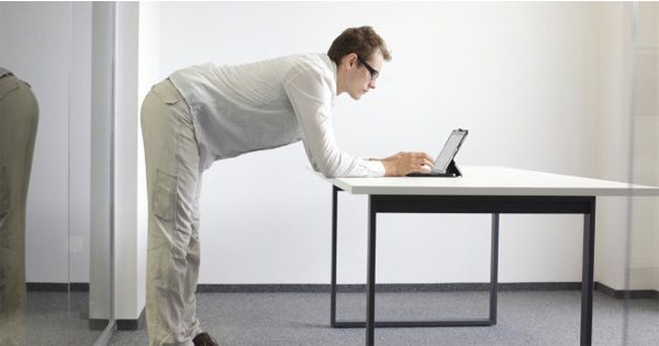 blog picture of man standing at desk