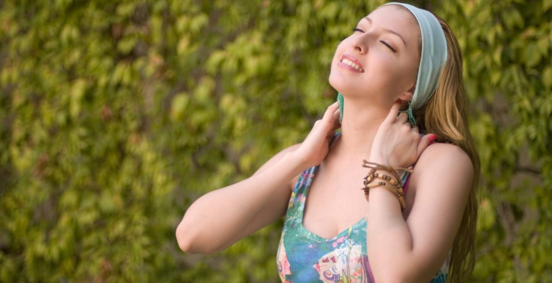 blog picture of young woman feeling good after chiropractic adjustment