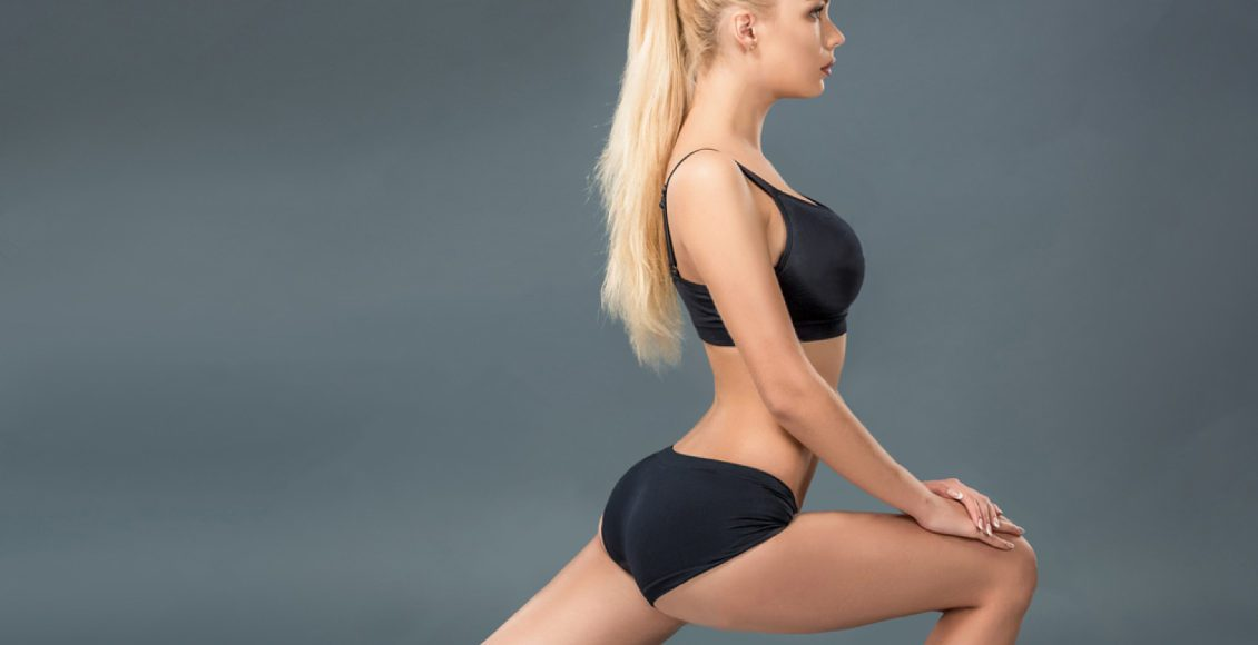 young beautiful woman in fitness wear stretching