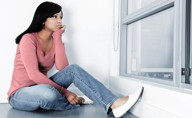 sad woman window